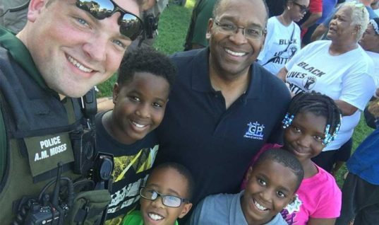 Dear Police Officers, Stop Exploiting Black Kids For Publicity Stunts