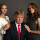 Ivanka Tump (Left) and Melania Trump (Right) pose behind Donald Trump (middle).